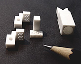 Small machined parts made of MACOR® glass ceramic from CORNING